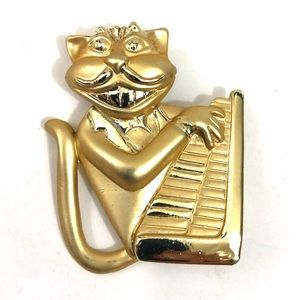 Vintage grinning cat keyboard brooch